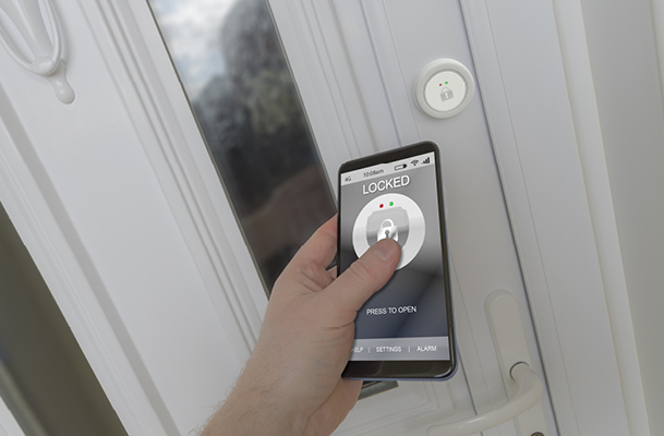 Person locking door by using an app on a smart phone